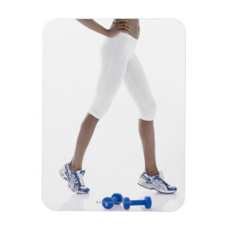 Young woman with dumbbells stretching (low vinyl magnet