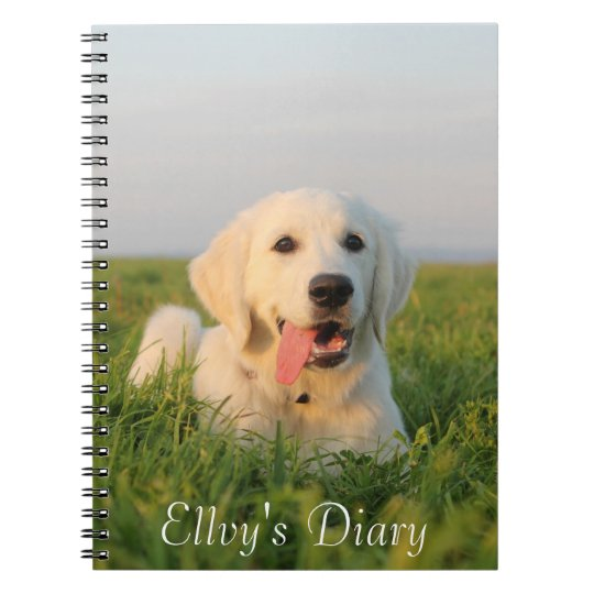 Your cute puppy on a spiral notebook