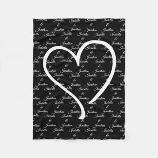 your names entwined beneath a large white heart fleece blanket