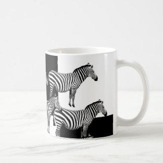 Zebras in black and white mugs