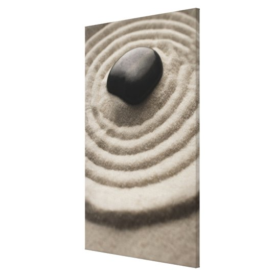 zen garden with pebble detail on raked sand canvas print