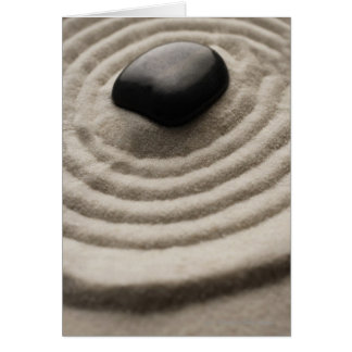 zen garden with pebble detail on raked sand card