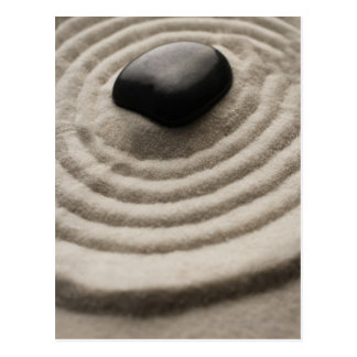 zen garden with pebble detail on raked sand postcard