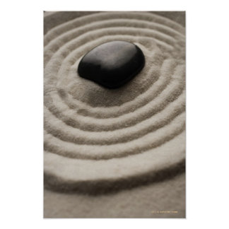 zen garden with pebble detail on raked sand poster