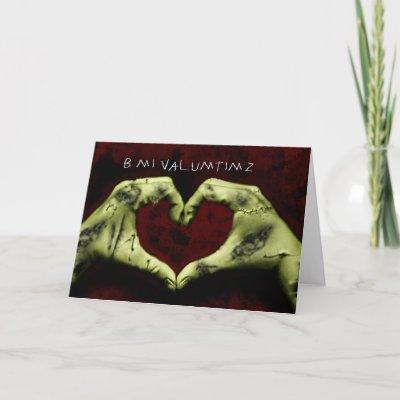 http://rlv.zcache.co.uk/zombie_valentine_card-p137086644318586185b2ico_400.jpg